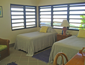 St John USVI Vacation Rental Soft Winds third bedroom with twin beds and native stonework