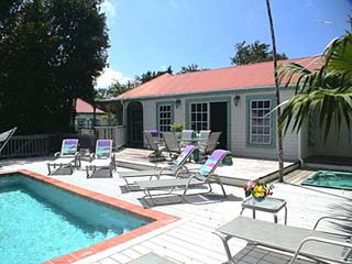 St John Rental Home Tree Tops large sun deck surrounding pool and many places to sun bathe